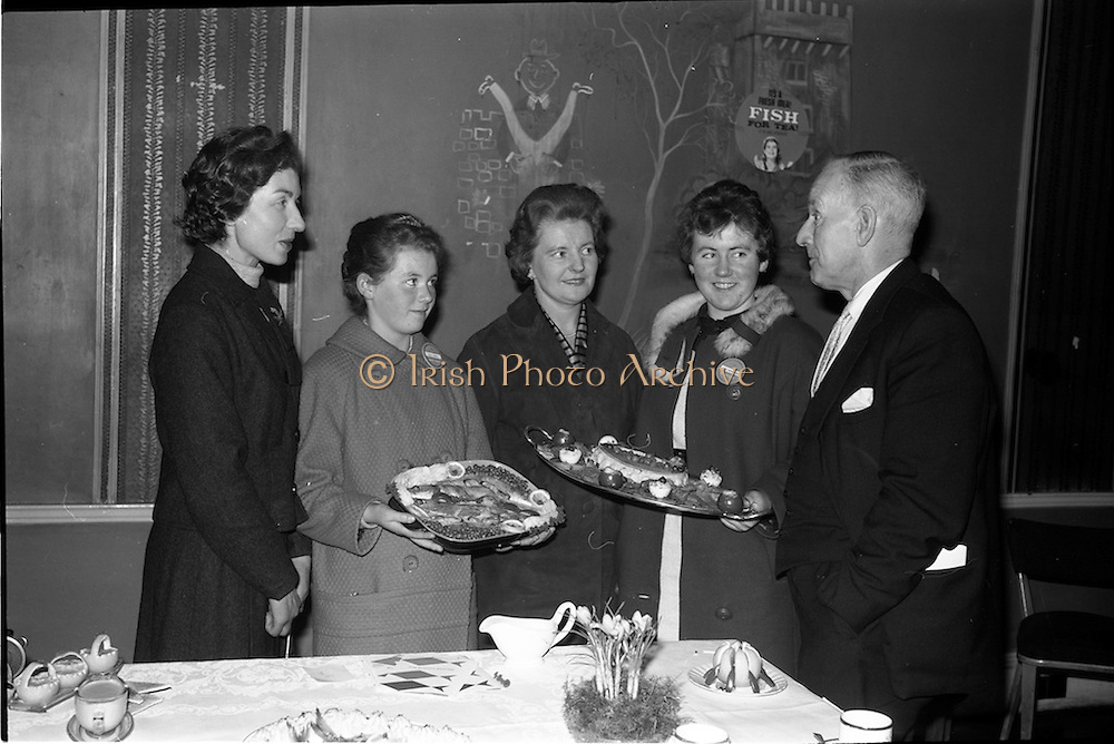03-04/03/1964<br /> 03/03-04/1964<br /> 03-04 March 1964<br /> B.I.M. Fish Cookery Competition, Munster final, winners at the Metropole Hotel, Cork. The competition was held at the School of Commerce Cork. Photo Shows: Mr. Denis ffrench, Home Market Manager, B.I.M. chatting with the prizewinners and their teachers. (l-r) Miss Mary O'Brien (Vocational School Killorglin); Miss Maisie Galvin, 3rd prize; Miss Eithne Beresford (Vocational School, Dungarvan) and Miss Phyllis Cliffe (1stprize).
