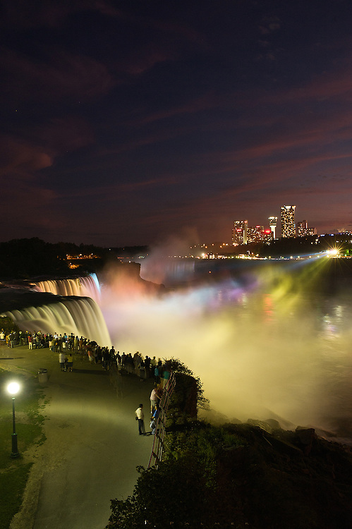 Niagara Falls, NY.<br /> <br /> The lights come from the Canadian side, the crowds from all over the world.  If you want to test the limits of your patience, this is one of the places to come and shoot.