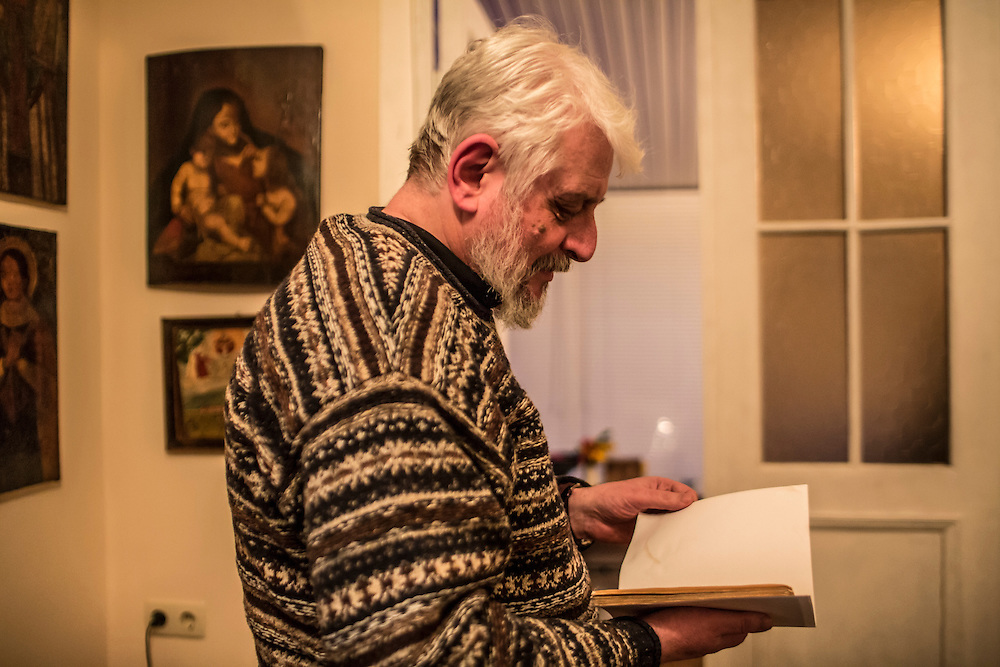 ODESSA, UKRAINE - MARCH 26, 2015: Poet Boris Khersonsky holds a copy of some of his early poetry from the 1970s in his home office in Odessa, Ukraine. CREDIT: Brendan Hoffman for The New York Times