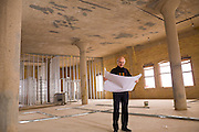 Heney Kypak, Architect, stands in a soon-to-be condominium unit on the 5th floor of the Rumley Building in Saskatoon.