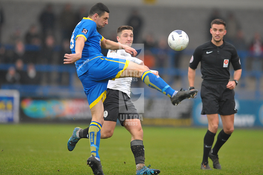TELFORD COPYRIGHT MIKE SHERIDAN Ben Tomlinson clears from Adam Walker of Telford during the Vanarama Conference North fixture between AFC Telford United and Alfreton Town at the New Bucks Head Stadium on Thursday, December 26, 2019.<br /> <br /> Picture credit: Mike Sheridan/Ultrapress<br /> <br /> MS201920-036