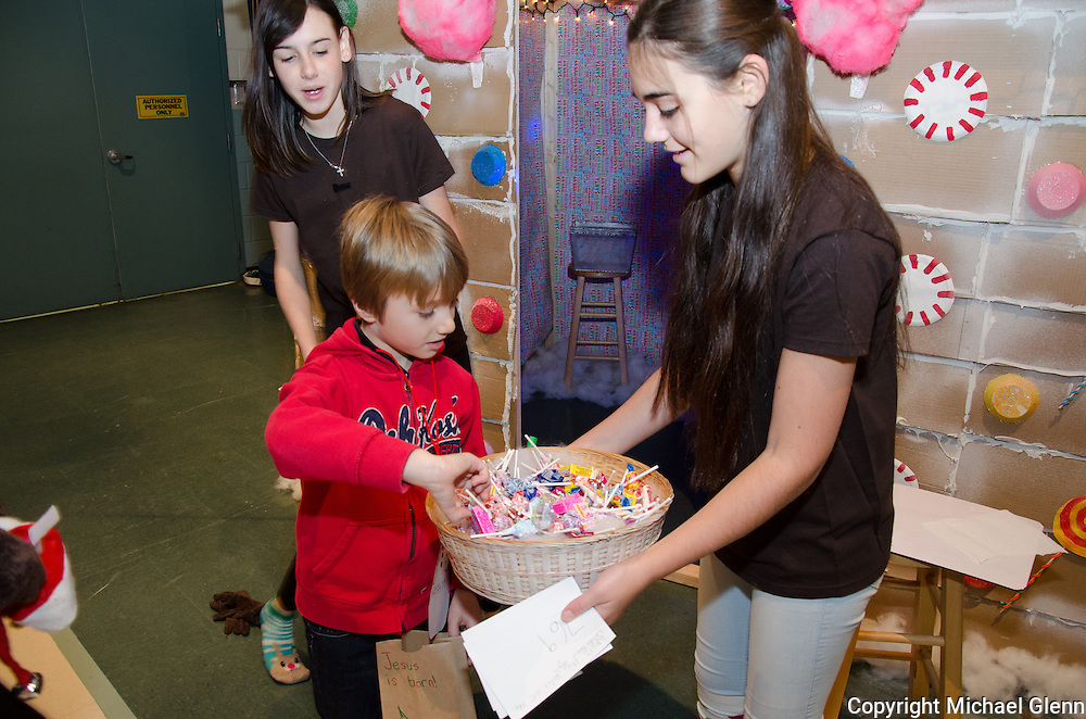 """19 Dec. 2013 Manahawkin USA Students get to build a gingerbread man in their annual """"Winter Wonderland"""" Math exhibit. Mateo gets his prize from Julia"""