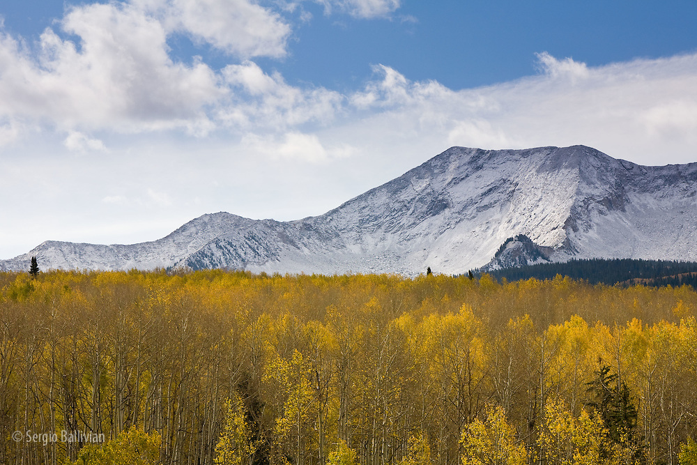 Light snow covers the high peaks above a carpet of Autumn colors in the West Elk mountains in SW Colorado.