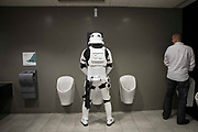 UNITED KINGDOM, London: 27 May 2018 A cosplay fan dressed as a Storm Trooper takes a toilet break at the MCM London Comic Con. The three day comic convention, which is held at London's ExCeL, was visited by thousands of avid cosplay fans and enthusiasts. Rick Findler / Story Picture Agency