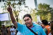 "01 FEBRUARY 2014 - BANGKOK, THAILAND: A Thai man screams at anti-government protestors blocking his access to the polls. He wanted to vote and was upset when protestors shut his polling place. Thais went to the polls in a ""snap election"" Sunday called in December after Prime Minister Yingluck Shinawatra dissolved the parliament in the face of large anti-government protests in Bangkok. The anti-government opposition, led by the People's Democratic Reform Committee (PDRC), called for a boycott of the election and threatened to disrupt voting. Many polling places in Bangkok were closed by protestors who blocked access to the polls or distribution of ballots. The result of the election are likely to be contested in the Thai Constitutional Court and may be invalidated because there won't be quorum in the Thai parliament.    PHOTO BY JACK KURTZ"