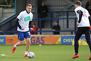 AFC Wimbledon striker Joe Pigott (39) and AFC Wimbledon defender Steve Seddon (15) warming up during the EFL Sky Bet League 1 match between AFC Wimbledon and Doncaster Rovers at the Cherry Red Records Stadium, Kingston, England on 9 March 2019.