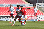 Accrington Stanley  Janoi Donacien (4) battles for the ball against Swindon Keshi Anderson (30) during the EFL Sky Bet League 2 match between Swindon Town and Accrington Stanley at the County Ground, Swindon, England on 5 May 2018. Picture by Gary Learmonth.