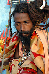 "India, Nasik, 2006. As a spiritual challenge and route to purification, this Hindu religious man, or ""sadhu,"" has been standing at this spot near the Godavari River for more than two years."