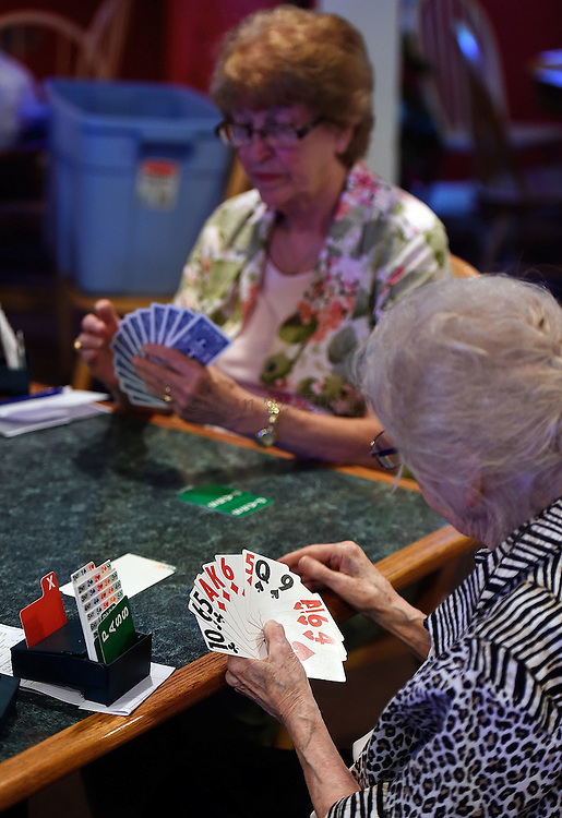 7/5/16 :: REGION :: BALDELLI :: Genevieve Rafferty, right, and Rosemary Dowsett, back, plot their next moves as members of the Faire Harbor Bridge Club plays their weekly game Tuesday, July 5, 2016 at The Lyme Tavern in Niantic. The club has been playing for over 100-years. (Sean D. Elliot/The Day)