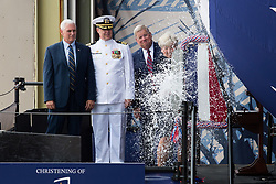 170429-O-NO101-001<br /> NEWPORT NEWS, Va. (April 29, 2017) Ship's Sponsor Diane Donald christens the Virginia-class submarine Indiana (SSN 789), witnessed by (from left) Vice President Mike Pence, Indiana's  Commanding Officer, Cdr. Jesse Zimbauer and Newport News Shipbuilding President Matt Mulherin. (U.S. Navy photo courtesy Huntington Ingalls Industries by Ashley Major/Released)