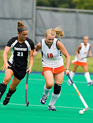 Virginia Cavaliers midfielder Pien Hulsebosch (19) shields the ball from Providence Friars midfielder Julie Ruggieri (21).  The Virginia Cavaliers field hockey team defeated the Providence College Friars on the University Hall Turf Field on the Grounds of the University of Virginia in Charlottesville, VA on August 31, 2008.