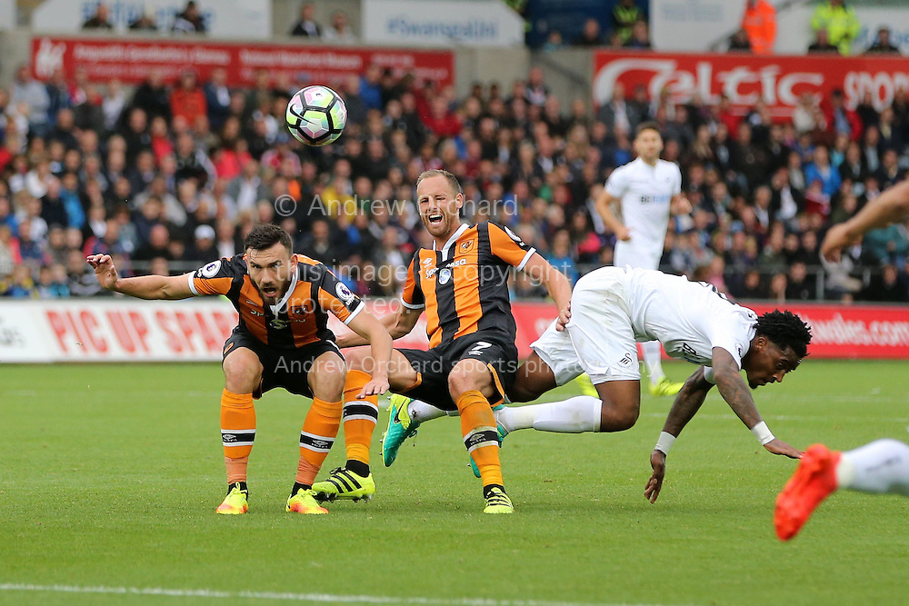 Robert Snodgrass of Hull city (l) and David Meyler of Hull city &copy; collide with Leroy Fer of Swansea city. Premier league match, Swansea city v Hull city at the Liberty Stadium in Swansea, South Wales on Saturday 20th August 2016.<br /> pic by Andrew Orchard, Andrew Orchard sports photography.