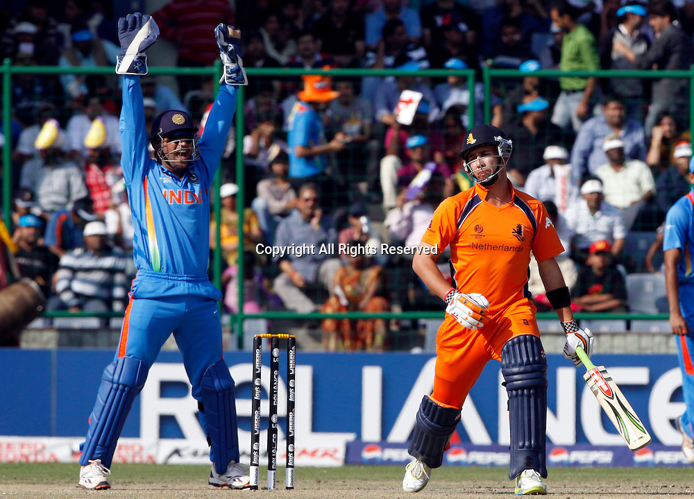 09.03.2011 Cricket World Cup from the Feroz Shah Kotla stadium in Delhi. India v Netherlands. Indian Captain Mahendra Singh Dhoni appeals unsuccessfully during the match of the ICC Cricket World Cup between India and Netherlands