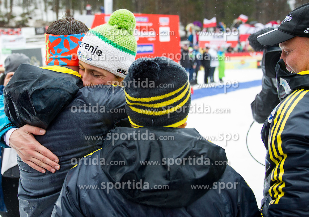 Peter Prevc of Slovenia celebrates with coaches Nejc Frank, Jani Grilc and Goran Janus as winner of the last competition, Ski Flying Champion and as second placed in overall classification after the  last Individual Competition in season 2013/14 at 4th day of FIS Ski Jumping World Cup Finals Planica 2014, on March 23, 2014 in Planica, Slovenia. Photo by Vid Ponikvar / Sportida