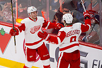 05 April 2014: Luke Glendening 41 of the Detroit Red Wings celebrates his goal with teammate Justin Abdelkader 8 during the NHL Eishockey Herren USA match against the Montreal Canadiens at the Bell Centre in Montreal Quebec, Canada. The Canadiens defeat the Red Wings 5-3. NHL Eishockey Herren USA APR 05 Red Wings at Canadiens <br />