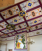 Inside Stirling Castle, unicorns in the Scottish King's Bedchamber symbolize royal purity & strength. What's with the unicorn? Unicorns were first depicted in 2600 BC in ancient seals of the Indus Valley Civilization and were mentioned by the ancient Greeks. In Celtic mythology the unicorn symbolized purity, innocence, masculinity and power. The proud, haughty unicorn was chosen as Scotland's national animal because it would rather die than be captured, just as Scots would fight to remain sovereign and unconquered. The unicorn was first used on the Scottish royal coat of arms by William I in the 1100s, and two unicorns supported the shield until 1603. When James VI became James I of England and Ireland in 1603, he replaced one unicorn with the national animal of England, the lion, to demonstrate unity. Believed to be the strongest of all animals, wild and untamed, the mythical unicorn could only be humbled by a virgin maiden. However, Scotland's unicorn in the coat of arms is always bounded by a golden chain, often shown around its neck and body, symbolizing the power of the Scottish kings, strong enough to tame a unicorn. Most of Stirling Castle's main buildings date from the 1400s and 1500s, when it peaked in importance. Scotland, United Kingdom, Europe. This image was stitched from several overlapping photos.