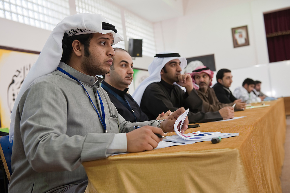 Candidates' representatives watch the vote at a polling station in Kuwait City during the February 2 parliamentary elections.. A total of 400,296 Kuwaiti men and women are eligible to vote to choose from among some 285 candidates, including more than 20 women candidates, for a new 50-seat parliament.