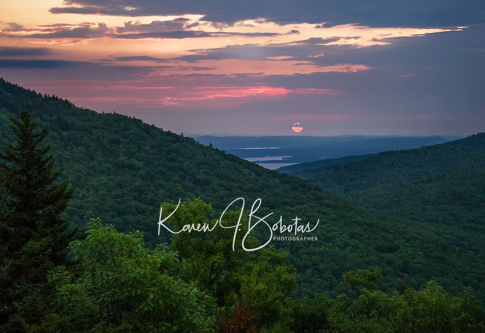 Sunrise from the top of Piper Mountain overlooking Lake Winnipesaukee.  (Karen Bobotas/for the Laconia Daily Sun)