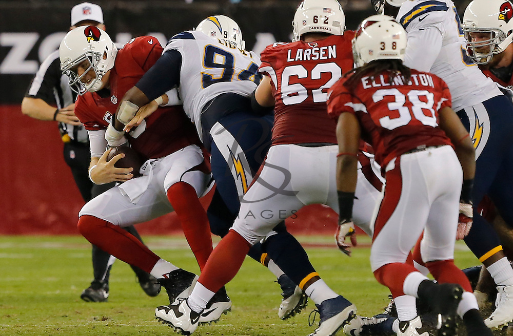 Arizona Cardinals quarterback Carson Palmer (3) is tackled by San Diego Chargers defensive end Corey Liuget (94) during the first half of an NFL football game, Monday, Sept. 8, 2014, in Glendale, Ariz. (AP Photo/Rick Scuteri)