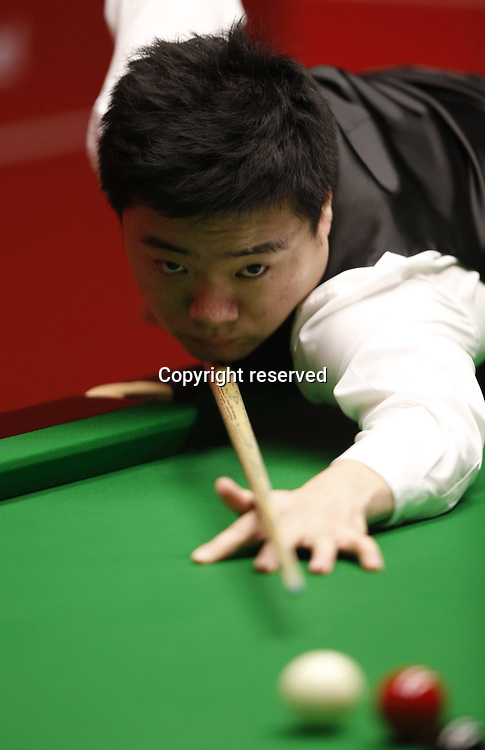 21.04.2014. Sheffield, England. Ding Junhui of China looks on during his round one match against Michael Wasley (Eng)on Day 2 of World Snooker Championship at the Crucible Theater in Sheffield, Britain, April 20, 2014.