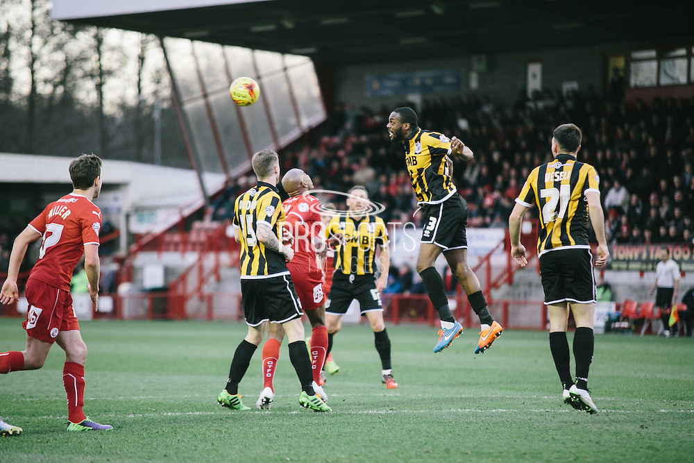 vales dickson defensive header during the Sky Bet League 1 match between Crawley Town and Port Vale at Broadfield Stadium, Crawley, England on 20 December 2014. Photo by Sam Shaw.