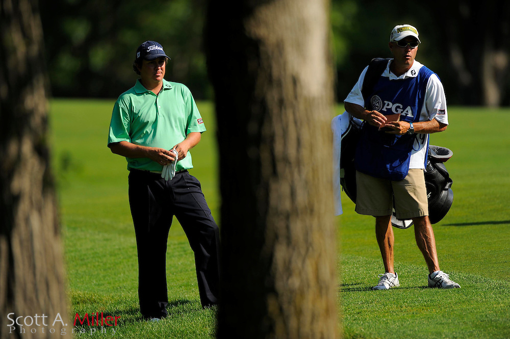 Aug 14, 2009; Chaska, MN, USA; Jason Dufner (USA) with his caddie near the trees during the second round of the 2009 PGA Championship at Hazeltine National Golf Club.  ©2009 Scott A. Miller