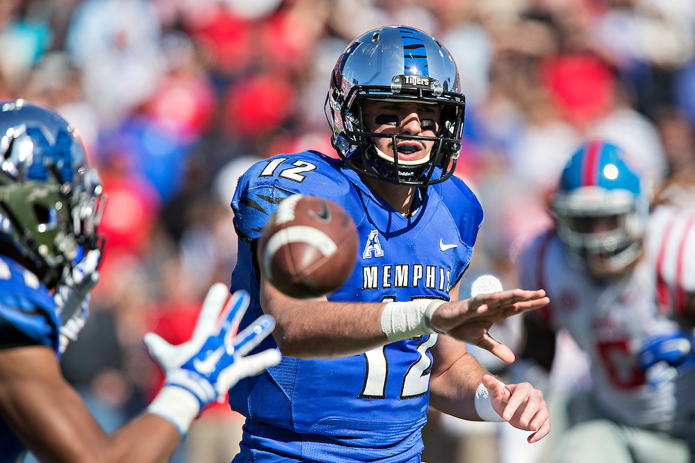 MEMPHIS, TN - OCTOBER 17:  Paxton Lynch #12 of the Memphis Tigers makes a pitch to the running back during a game against the Ole Miss Rebels at Liberty Bowl Memorial Stadium on October 17, 2015 in Memphis, Tennessee.  The Tigers defeated the Rebels 37-24.  (Photo by Wesley Hitt/Getty Images) *** Local Caption *** Paxton Lynch
