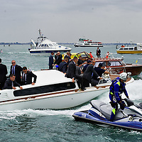 VENICE, ITALY - JUNE 03: Speacial branches police on a white speed boat and heavy security accompany the power boat of  Israel President Shimon Peres in St. Mark's Basin after visiting  the Venice Biennale on June 3, 2011 in Venice, Italy.  This year's Biennale is the 54th edition and will run from June 4th until 27 November.