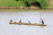 Africa, Ethiopia, Omo Valley, Daasanach tribe woman rows a canoe in the river