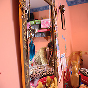Linda shares her bedroom with her daughter. She says that