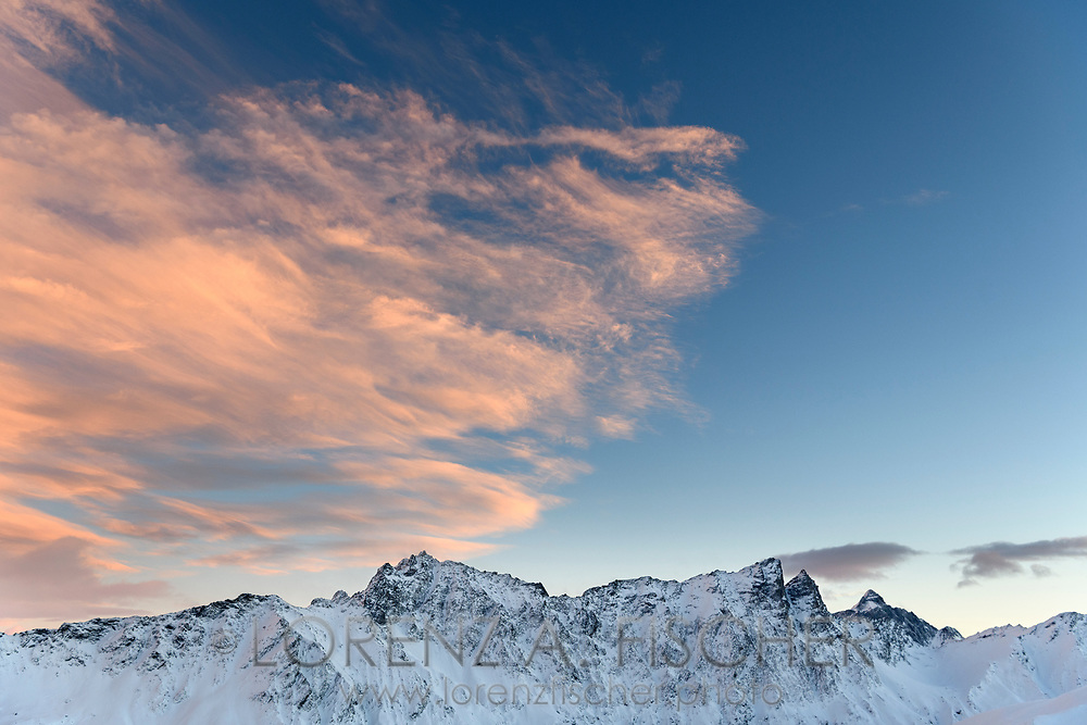 The peaks of Piz Arblatsch, Piz Forbesch and Piz Platta in the last sunlight of the day, Parc Ela, Grisons, Switzerland