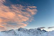 The peaks of Piz Arblatsch, Piz Forbesch and Piz Platta in the last sunlight of the day, Parc Ela, Grisons, Switzerland