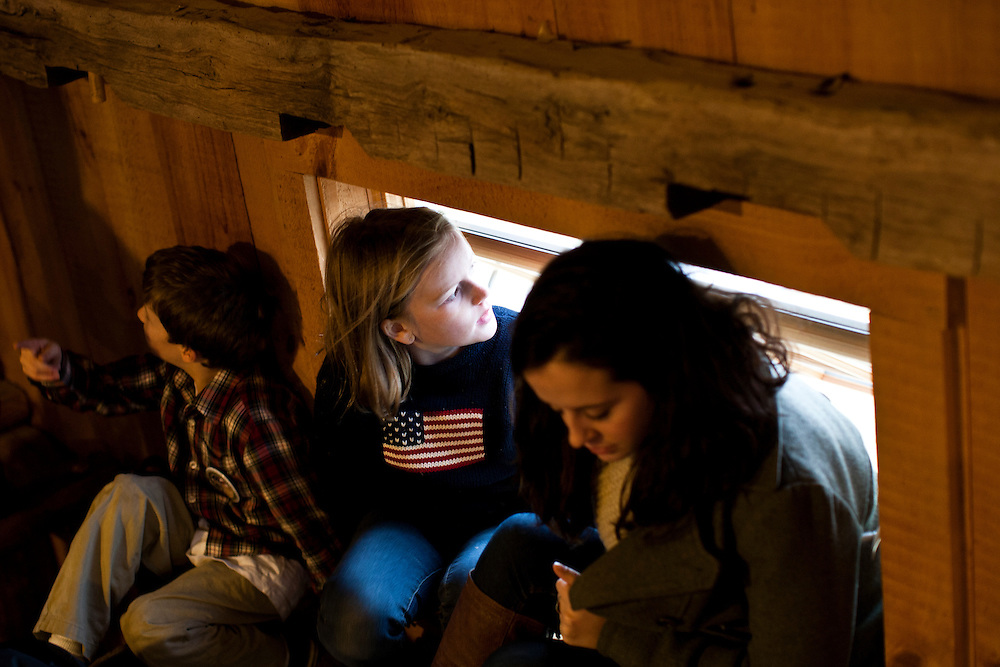 Children sit in the rafters as Republican presidential candidate Rick Santorum hosts a town hall meeting at Lawrence Barn on Saturday, January 7, 2012 in Hollis, NH. Brendan Hoffman for the New York Times