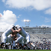 Penn State offensive linemen run through warm up drills before the start of the annual Blue/White game on April 20, 2013 at Beaver Stadium in University Park, PA.