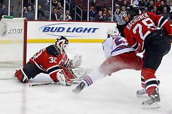 February 1, 2008; Newark, NJ, USA;  New Jersey Devils goalie Martin Brodeur (30) makes a save on New York Rangers left wing Petr Prucha (25) during the first period at the Prudential Center in Newark, NJ.