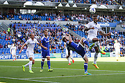 Kyle Bartley of Leeds United evades Aron Gunnarsson of Cardiff City during the EFL Sky Bet Championship match between Cardiff City and Leeds United at the Cardiff City Stadium, Cardiff, Wales on 17 September 2016. Photo by Andrew Lewis.