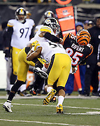 Cincinnati Bengals tight end Tyler Eifert (85) gets gang tackled by Pittsburgh Steelers inside linebacker Ryan Shazier (50) and Pittsburgh Steelers cornerback Antwon Blake (41) after catching a first quarter pass for a gain of 7 yards during the NFL AFC Wild Card playoff football game against the Pittsburgh Steelers on Saturday, Jan. 9, 2016 in Cincinnati. The Steelers won the game 18-16. (©Paul Anthony Spinelli)