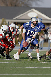 25 November 2006: Cole Stinson looks to make a shuffle pass in the back field. &#xD;The Redbirds romped the Panthers by a score of 24-13.&#xD;This game was a 1st round NCAA Division 1 Playoff held at O'Brien Stadium on the campus of Eastern Illinois University in Charleston Illinois.<br />