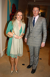 LADY SYBILLA RUFUS-ISAACS and MR ANDREW HURST at a fundraising evening for the Conservative Party General Election Campaign Fund held at Bonhams, 101 New Bond Street, London W1 on 17th March 2005.<br /><br />NON EXCLUSIVE - WORLD RIGHTS