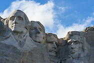 Clouds move past Mount Rushmore in the Black Hills of South Dakota.