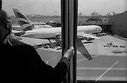 """Scene from the AirTrain at Newark International Airport. British Airlines, 767. Flight to London-Heathrow...Part of long-term (2005-2008) story """"I See A Darkness"""". New York, NY."""