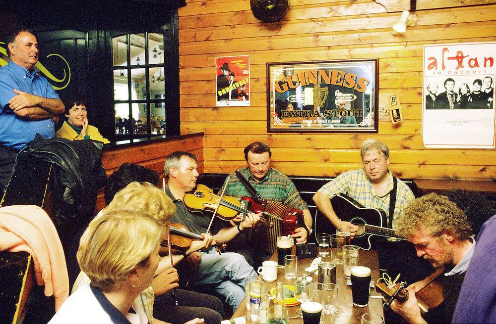 Traditional Irish pub music session in Days Bar on the west coast island of Inishbofin, County Galway, Ireland.