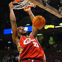 (SPORTS) East Rutherford 1/2/2003   The Cavs LeBron Lames slams home a ball on a fast break over the Nets Robert Pack in th second quarter.  EDS  NOT TACK SHARP!  Michael J. Treola Staff Photographer....MJT