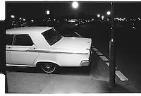 Night shot of half a white car on the Blackheath, London street photography in 1982. Tri-X