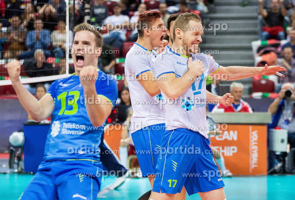 Jani Kovacic #13 of Slovenia, Jan Kozamernik #10 of Slovenia, Tine Urnaut #17 of Slovenia celebrate during volleyball match between National teams of Slovenia and Italy in 1st Semifinal of 2015 CEV Volleyball European Championship - Men, on October 17, 2015 in Arena Armeec, Sofia, Bulgaria. Photo by Vid Ponikvar / Sportida
