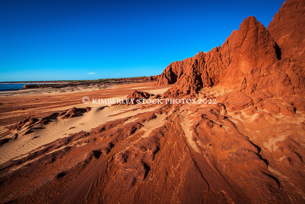 Dramatic red pindan cliffs contrast with blue sky at James Price Point north of Broome.  James Price Point is the site of a proposed LNG processing facility.