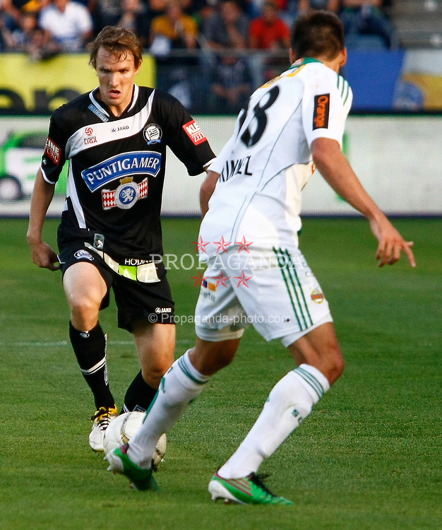 13.08.2011, UPC Arena, Graz, AUT, 1. FBL, SK Puntigamer Sturm Graz vs SK Rapid Wien, im Bild Andreas Hoelzl (SK Sturm Graz, #8, Midfield) und Christopher Trimmel (SK Rapid Wien, #28), EXPA Pictures © 2011, PhotoCredit: EXPA/ Erwin Scheriau