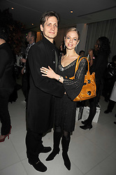 Dancers AGNES OAKES and THOMAS EDUR at a reception before the launch of the English National Ballet Christmas season launch of The Nutcracker held at the St,Martins Lane Hotel, London on 5th December 2008.