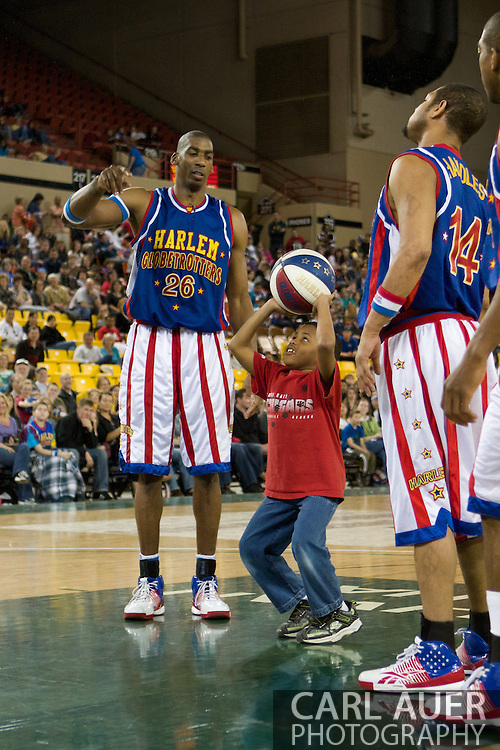April 30th, 2010 - Anchorage, Alaska:  Hi-Lite Bruton brings another fan on the court to experience the Globetrotter magic.