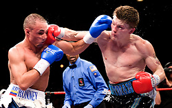 Ricky Hatton of England attacks Paulie Malinaggi of USA during their Light-welterweight title fight at the MGM Grand Garden Arena on November 22, 2008 in Las Vegas, Nevada.